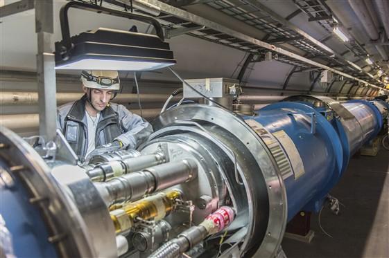 Photo of man examining accelerator